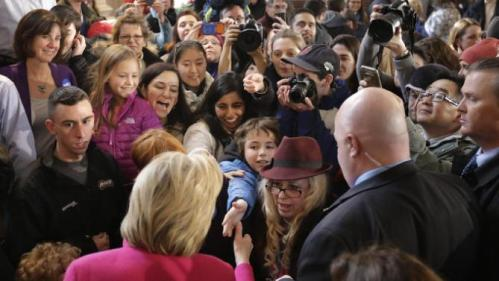 Democratic presidential candidate Hillary Clinton, below left, greets people at the conclusion of a town hall style campaign event, Tuesday, Dec. 29, 2015, at South Church in Portsmouth, N.H. (AP Photo/Steven Senne)