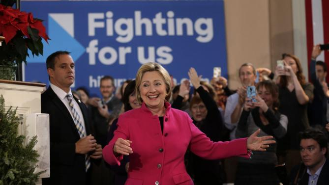 Democratic presidential candidate Hillary Clinton, center, smiles as she arrives at a campaign event Tuesday, Dec. 29, 2015, at South Church, in Portsmouth, N.H. (AP Photo/Steven Senne)