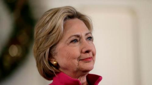 Democratic presidential candidate Hillary Clinton listens during a town hall style campaign event Tuesday, Dec. 29, 2015, at South Church, in Portsmouth, N.H. (AP Photo/Steven Senne)