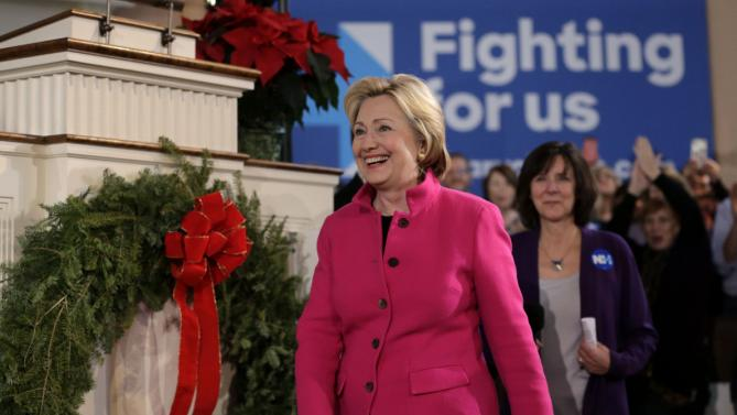 Democratic presidential candidate Hillary Clinton smiles as she arrives at a town hall style campaign event, Tuesday, Dec. 29, 2015, at South Church in Portsmouth, N.H. (AP Photo/Steven Senne)