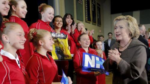 U.S. Democratic presidential candidate Hillary Clinton greets members of the Red Star Twirlers, who performed at her campaign town hall meeting, in Derry, New Hampshire January 3, 2016. REUTERS/Brian Snyder