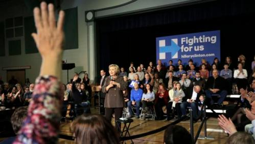 Democratic presidential candidate Hillary Clinton, center, takes questions during a town hall campaign event Sunday, Jan. 3, 2016, in Derry, N.H. (AP Photo/Steven Senne)