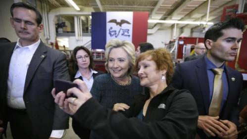 Democratic presidential candidate Hillary Clinton poses for a photo with Cynthia Johnson of Osage, Iowa, during a campaign stop at the Osage Public Safety Center, Tuesday, Jan. 5, 2016, in Osage, Iowa. (AP Photo/Charlie Neibergall)