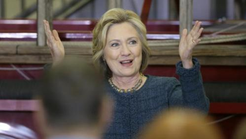 Democratic presidential candidate Hillary Clinton reacts to supporters during a campaign stop at the Osage Public Safety Center, Tuesday, Jan. 5, 2016, in Osage, Iowa. (AP Photo/Charlie Neibergall)