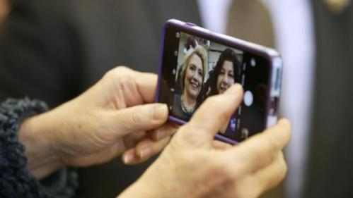 Democratic presidential candidate Hillary Clinton takes a selfie photo with a supporter during a campaign stop at the Osage Public Safety Center, Tuesday, Jan. 5, 2016, in Osage, Iowa. (AP Photo/Charlie Neibergall)