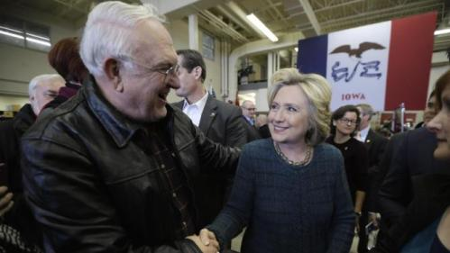 Democratic presidential candidate Hillary Clinton talks with Paul Bodtke of Osage, Iowa during a campaign stop at the Osage Public Safety Center, Tuesday, Jan. 5, 2016, in Osage, Iowa. (AP Photo/Charlie Neibergall)