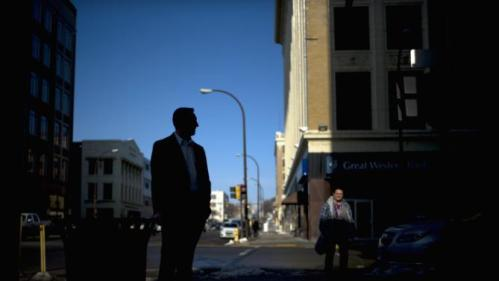 A Secret Service agent stands outside the Orpheum Theatre in Sioux City, Iowa, Tuesday, Jan. 5, 2016, where Democratic presidential candidate Hillary Clinton is scheduled to host a rally. (AP Photo/Jae C. Hong)