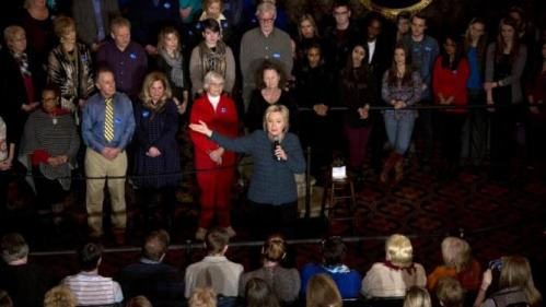 Democratic presidential candidate Hillary Clinton, center, addresses supporters during a rally at the Orpheum Theatre, Tuesday, Jan. 5, 2016, in Sioux City, Iowa. (AP Photo/Jae C. Hong)