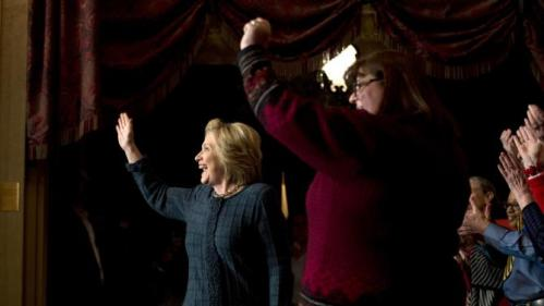 Democratic presidential candidate Hillary Clinton, left, waves as she is introduced at a rally at the Orpheum Theatre, Tuesday, Jan. 5, 2016, in Sioux City, Iowa. (AP Photo/Jae C. Hong)