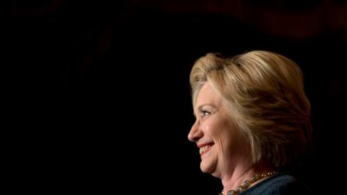 Democratic presidential candidate Hillary Clinton smiles while speaking at a rally at the Orpheum Theatre, Tuesday, Jan. 5, 2016, in Sioux City, Iowa. (AP Photo/Jae C. Hong)