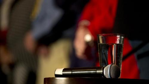 A microphone and a glass of water are placed on a stool for Democratic presidential candidate Hillary Clinton at a rally, Tuesday, Jan. 5, 2016, in Sioux City, Iowa. (AP Photo/Jae C. Hong)