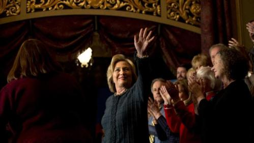 Democratic presidential candidate Hillary Clinton, center, is introduced at a rally held at the Orpheum Theatre, Tuesday, Jan. 5, 2016, in Sioux City, Iowa. (AP Photo/Jae C. Hong)