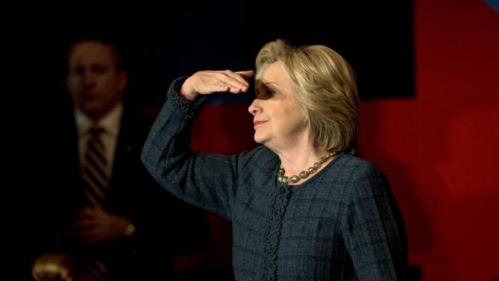 Democratic presidential candidate Hillary Clinton shields her eyes from the light while listening to a question during a rally held at the Orpheum Theatre, Tuesday, Jan. 5, 2016, in Sioux City, Iowa. (AP Photo/Jae C. Hong)