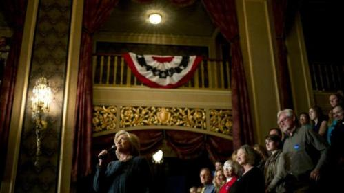Democratic presidential candidate Hillary Clinton, left, speaks at a rally held at the Orpheum Theatre, Tuesday, Jan. 5, 2016, in Sioux City, Iowa. (AP Photo/Jae C. Hong)