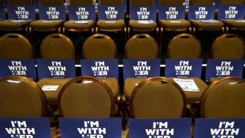 Signs for supporters of Democratic presidential candidate Hillary Clinton are displayed at a Democratic fundraising dinner featuring all three candidates in Las Vegas, Nevada, January 6, 2016.  Martin O'Malley and Bernie Sanders were also expected to attend.  REUTERS/Rick Wilking