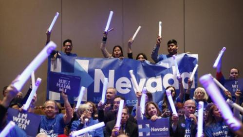 Supporters of Democratic presidential candidate Hillary Clinton cheer during the Battle Born Battleground First in the West Caucus Dinner, Wednesday, Jan. 6, 2016, in Las Vegas. (AP Photo/John Locher)