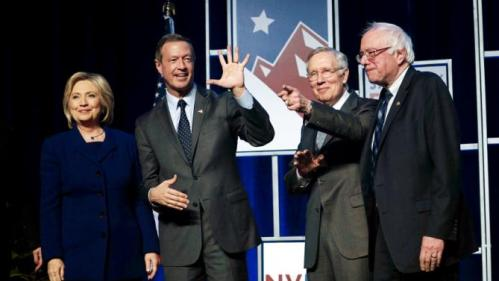 Democratic presidential candidates pose on stage before a fundraiser in Las Vegas, Nevada January 6, 2016. Left to right are Hillary Clinton, Martin O'Malley, Senator Harry Reid (D-NV) and Bernie Sanders. REUTERS/Rick Wilking TPX IMAGES OF THE DAY