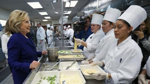 U.S. Democratic presidential candidate Hillary Clinton talks to students making lasagna while touring the Culinary Academy of Las Vegas in North Las Vegas, Nevada January 6, 2016. REUTERS/Rick Wilking