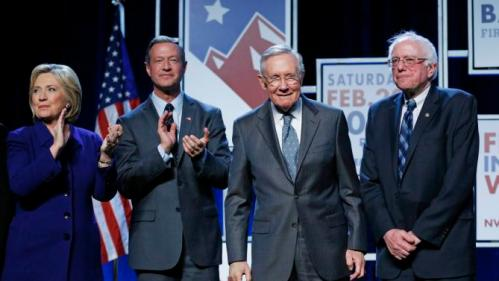 Democratic presidential candidates Hillary Clinton, left, Martin O'Malley, second from left, and Sen. Bernie Sanders, I-Vt., right, stand on stage with Senate Minority Leader Harry Reid, D-Nev., during the Battle Born Battleground First in the West Caucus Dinner, Wednesday, Jan. 6, 2016, in Las Vegas. (AP Photo/John Locher)