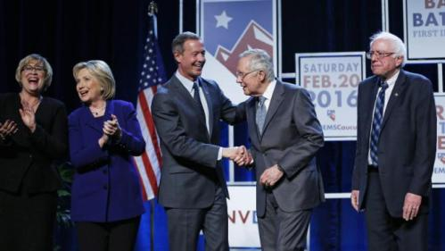 From left, Roberta Lange, chairwoman of the Nevada State Democratic Party, Democratic presidential candidate Hillary Clinton, Democratic presidential candidate, former Maryland Gov. Martin O'Malley, Senate Minority Leader Harry Reid, D-Nev., and Democratic presidential candidate Sen. Bernie Sanders, I-Vt., stand on stage during the Battle Born Battleground First in the West Caucus Dinner, Wednesday, Jan. 6, 2016, in Las Vegas. (AP Photo/John Locher)