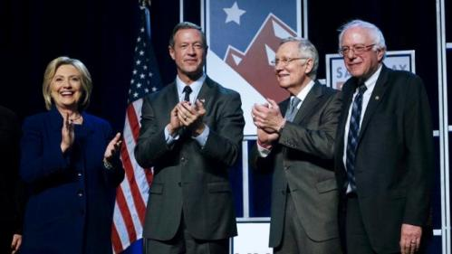 Democratic presidential candidates Hillary Clinton, Martin O'Malley (2nd L) and Bernie Sanders (R) applaud on stage with Sen. Harry Reid (D-NV) at a Democratic fundraising dinner in Las Vegas, Nevada, January 6, 2016.  REUTERS/Rick Wilking