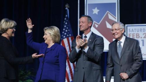 Democratic presidential candidates Hillary Clinton, second from left, and Martin O'Malley, second from right, stand on stage with Senate Minority Leader Harry Reid, D-Nev., right and Roberta Lange, chairwoman of the Nevada State Democratic Party, during the Battle Born Battleground First in the West Caucus Dinner, Wednesday, Jan. 6, 2016, in Las Vegas. (AP Photo/John Locher)