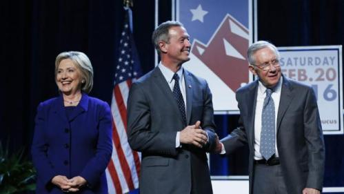Democratic presidential candidates Hillary Clinton, left, and Martin O'Malley, second from left, stand on stage with Senate Minority Leader Harry Reid, D-Nev., during the Battle Born Battleground First in the West Caucus Dinner, Wednesday, Jan. 6, 2016, in Las Vegas. (AP Photo/John Locher)