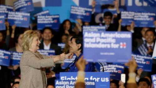 Democratic presidential candidate Hillary Clinton, left, is welcomed by Rep. Judy Chu, D-Calif., before addressing Asian American and Pacific Islander supporters in San Gabriel, Calif., Thursday, Jan. 7, 2016. (AP Photo/Damian Dovarganes)
