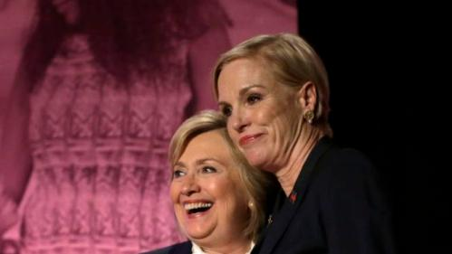 Democratic presidential candidate Hillary Clinton, left, stands with CecileRichards, Planned Parenthood's president, right, during an event Sunday, Jan. 10, 2016, in Hooksett, N.H., during which Planned Parenthood endorsed Clinton in the presidential race. The endorsement by the group's political arm marks Planned Parenthood's first time wading into a presidential primary. (AP Photo/Steven Senne)