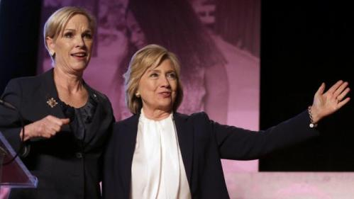 Democratic presidential candidate Hillary Clinton, right, stands with CecileRichards, Planned Parenthood's president, during an event Sunday, Jan. 10, 2016, in Hooksett, N.H., during which Planned Parenthood endorsed Clinton in the presidential race. The endorsement by the group's political arm marks Planned Parenthood's first time wading into a presidential primary. (AP Photo/Steven Senne)