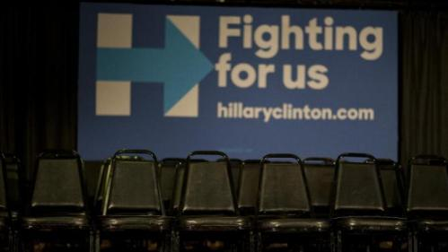 Chairs are placed behind the podium at a rally with Democratic presidential candidate Hillary Clinton Monday, Jan. 11, 2016, in Waterloo, Iowa. (AP Photo/Jae C. Hong)