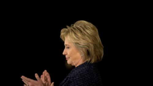 Democratic presidential candidate Hillary Clinton applauds while listening to Transportation Secretary Anthony Foxx speaks during a campaign rally, Monday, Jan. 11, 2016, in Waterloo, Iowa. (AP Photo/Jae C. Hong)