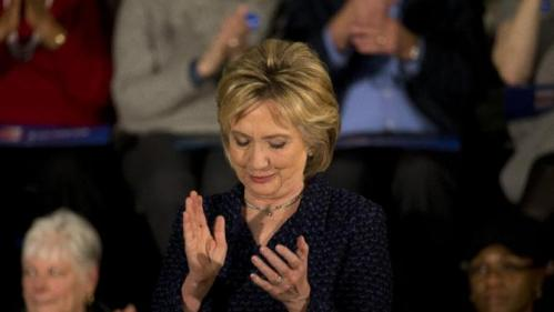 Democratic presidential candidate Hillary Clinton applauds while listening to Transportation Secretary Anthony Foxx at a rally Monday, Jan. 11, 2016, in Waterloo, Iowa. (AP Photo/Jae C. Hong)