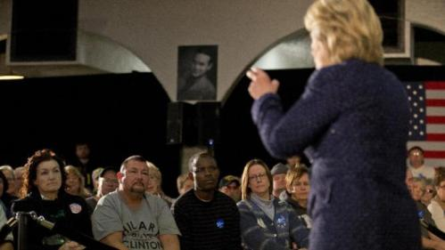 People listens to Democratic presidential candidate Hillary Clinton at a rally Monday, Jan. 11, 2016, in Waterloo, Iowa. (AP Photo/Jae C. Hong)