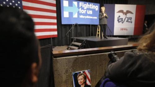 A photograph of Democratic presidential candidate Hillary Clinton sits in front of an attendee as Clinton speaks during a campaign event at Iowa State University in Ames, Iowa, Tuesday, Jan. 12, 2016. (AP Photo/Patrick Semansky)