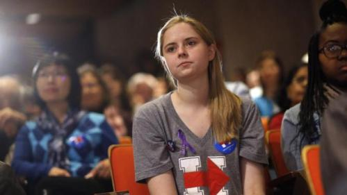 Iowa State University student Colette Manley listens as Democratic presidential candidate Hillary Clinton speaks during a campaign event on the university campus in Ames, Iowa, Tuesday, Jan. 12, 2016. (AP Photo/Patrick Semansky)