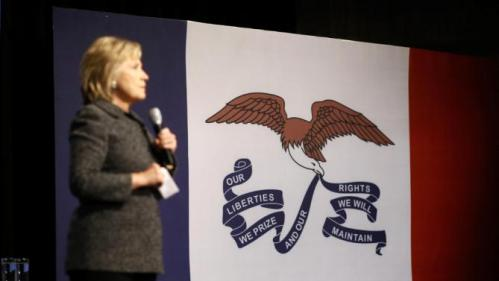 The Iowa state flag is seen at right as Democratic presidential candidate Hillary Clinton speaks during a campaign event at Iowa State University in Ames, Iowa, Tuesday, Jan. 12, 2016. (AP Photo/Patrick Semansky)