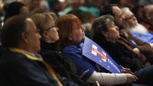 People listen to Democratic presidential candidate Hillary Clinton speak during a campaign event at Iowa State University in Ames, Iowa, Tuesday, Jan. 12, 2016. (AP Photo/Patrick Semansky)