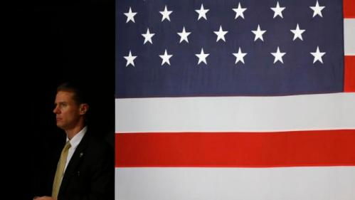 A U.S. Secret Service agent stands off stage as Democratic presidential candidate Hillary Clinton speaks during a campaign event at Iowa State University in Ames, Iowa, Tuesday, Jan. 12, 2016. (AP Photo/Patrick Semansky)