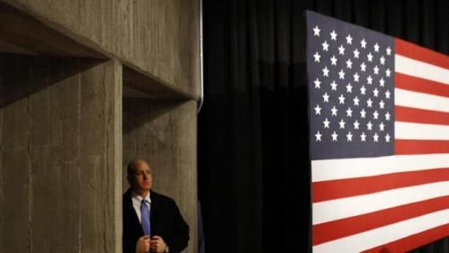 A U.S. Secret Service agent stands off stage before a campaign event featuring Democratic presidential candidate Hillary Clinton at Iowa State University in Ames, Iowa, Tuesday, Jan. 12, 2016. (AP Photo/Patrick Semansky)
