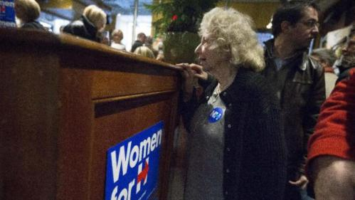 A supporter watches Chelsea Clinton during a campaign stop for her mother Democratic presidential candidate Hillary Clinton at Portsmouth Brewery, Tuesday, Jan. 12, 2016, in Portsmouth, N.H. (AP Photo/John Minchillo)
