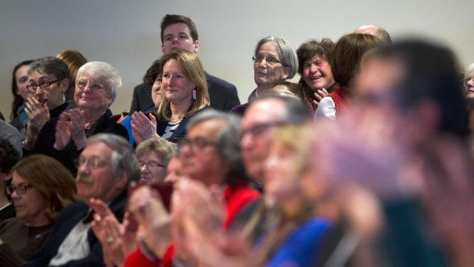 Attendees applaud former President Bill Clinton during a campaign stop for his wife, Democratic presidential candidate Hilary Clinton, Wednesday, Jan. 13, 2016, at Keene State College in Keene, N.H. (AP Photo/Matt Rourke)