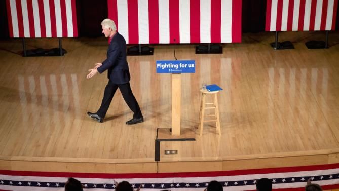 Former President Bill Clinton walks off the stage during a campaign stop for his wife, Democratic presidential candidate Hilary Clinton, Wednesday, Jan. 13, 2016, at Keene State College in Keene, N.H. (AP Photo/Matt Rourke)