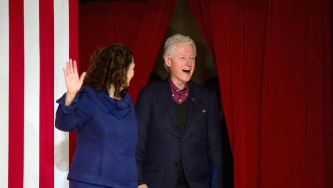 Former President Bill Clinton, accompanied by state Sen. Molly Kelly walks onto the stage during a campaign stop for his wife, Democratic presidential candidate Hillary Clinton, Wednesday, Jan. 13, 2016, at Keene State College in Keene, N.H. (AP Photo/Matt Rourke)