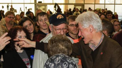 Former President Bill Clinton meets with members of his audience after speaking at a campaign event for his wife, Democratic presidential candidate Hillary Clinton, Friday, Jan. 15, 2016, at Morningside College in Sioux City, Iowa. (AP Photo/Nati Harnik)