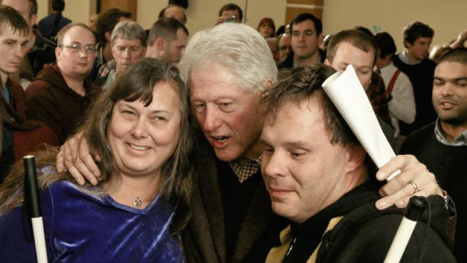 Former President Bill Clinton poses for a photo with members of the audience after speaking at a campaign event for his wife, Democratic presidential candidate Hillary Clinton, Friday, Jan. 15, 2016, at Morningside College in Sioux City, Iowa.  (AP Photo/Nati Harnik)