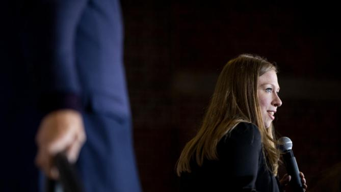 Chelsea Clinton, right, accompanied by her father Former President Bill Clinton, left, speaks at a campaign stop for her mother, Democratic presidential candidate Hillary Clinton at Lincoln High School in Des Moines, Iowa, Saturday, Jan. 16, 2016(AP Photo/Andrew Harnik)