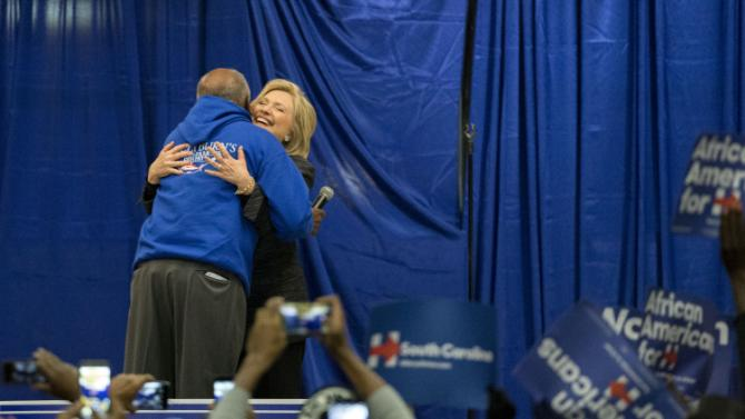 Democratic presidential candidate Hillary Clinton hugs Rep. Jim Clyburn (D-SC), left. before she speak to a crowd at the Jim Clyburn Fish Fry, on Saturday, Jan. 16, 2016, at the Charleston Visitor Center in Charleston, S.C. (AP Photo/Stephen B. Morton)