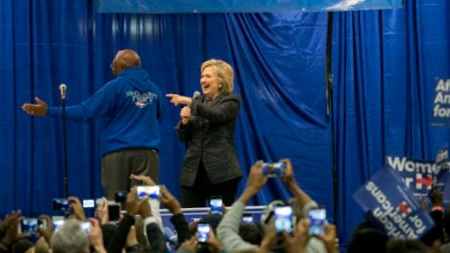 Democratic presidential candidate Hillary Clinton points to a supporter after she is introduced by Rep. Jim Clyburn (D-SC), left. before she speak to a crowd at the Jim Clyburn Fish Fry, on Saturday, Jan. 16, 2016, at the Charleston Visitor Center in Charleston, S.C. (AP Photo/Stephen B. Morton)