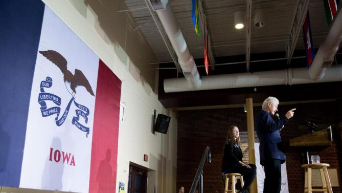 Former President Bill Clinton, accompanied by his daughter Chelsea Clinton, speaks at a campaign stop for his wife Democratic presidential candidate Hillary Clinton at Lincoln High School in Des Moines, Iowa, Saturday, Jan. 16, 2016(AP Photo/Andrew Harnik)